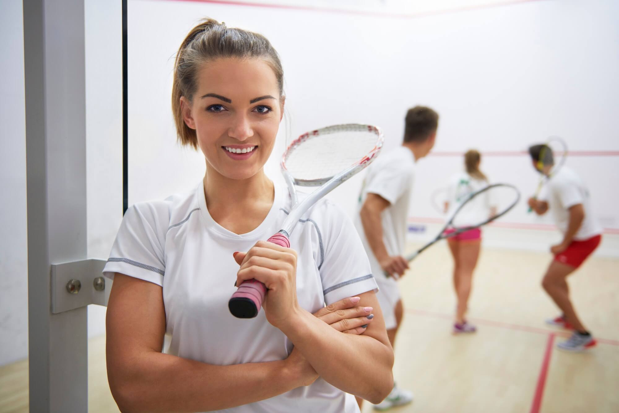 Squash player and people in the background